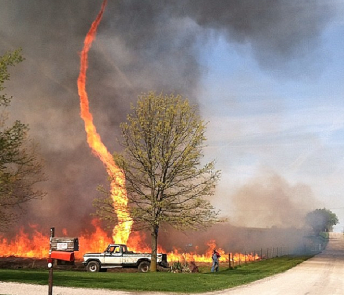 Fire Damage Sudden, Swirling Firenado Rises out of Farm Fire