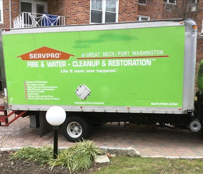 A SERVPRO van parked in a driveway.