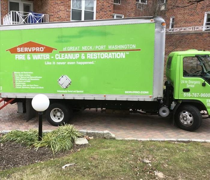 servpro box truck parked in front of brick unit
